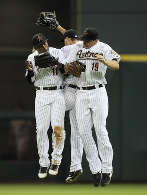 HOUSTON - AUGUST 29:  Brian Bogusevic #19, Jason Bourgeois #11 and Jordan Schafer, rear, of the Houston Astros celebrate after defeating the Pittsburgh Pirates 7-4 at Minute Maid Park on August 29, 2011 in Houston, Texas.  (Photo by Bob Levey/Getty Images