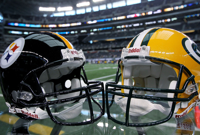 ARLINGTON, TX - FEBRUARY 06:  The helmets of the Pittsburgh Steelers and the Green Bay Packers are displayed before Super Bowl XLV at Cowboys Stadium on February 6, 2011 in Arlington, Texas.  (Photo by Doug Pensinger/Getty Images)