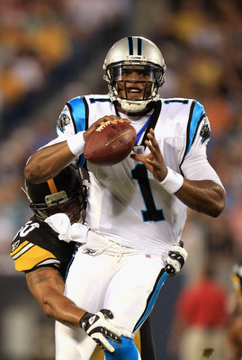 CHARLOTTE, NC - SEPTEMBER 01:  Larry Foote #50 of the Pittsburgh Steelers tries to tackle Cam Newton #1 of the Carolina Panthers during their preseason game at Bank of America Stadium on September 1, 2011 in Charlotte, North Carolina.  (Photo by Streeter