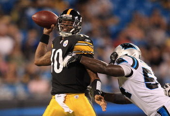 CHARLOTTE, NC - SEPTEMBER 01:  Dennis Dixon #10 of the Pittsburgh Steelers tries to get away from Jason Williams #54 of the Carolina Panthers during their preseason game at Bank of America Stadium on September 1, 2011 in Charlotte, North Carolina.  (Photo