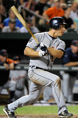 BALTIMORE, MD - AUGUST 12:  Andy Dirks #12 of the Detroit Tigers hits a single in the sixth inning against the Baltimore Orioles at Oriole Park at Camden Yards on August 12, 2011 in Baltimore, Maryland. Detroit won the game 5-4.  (Photo by Greg Fiume/Gett
