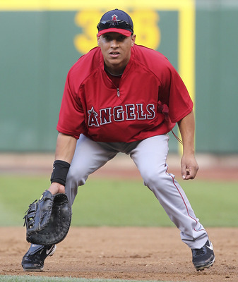 SEATTLE - SEPTEMBER 01:  First baseman Efren Navarro #19 of the Los Angeles Angels of Anaheim takes infield practice prior to the game against the Seattle Mariners at Safeco Field on September 1, 2011 in Seattle, Washington. (Photo by Otto Greule Jr/Getty