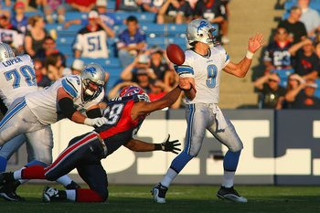 ORCHARD PARK, NY - SEPTEMBER 3:  Aaron Maybin #58 of the Buffalo Bills strips the football from Matthew Stafford #9 of the Detroit Lions, causing a fumble during the preseason game at Ralph Wilson Stadium on September 3, 2009 in Orchard Park, New York. (P