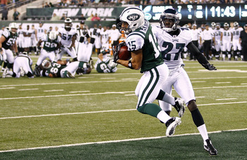 EAST RUTHERFORD, NJ - SEPTEMBER 01:   Scotty McKnight #15 of the New York Jets pulls in a touchdown in front of  Brandon Hughes #27 of the Philadelphia Eagles during their pre-season game at MetLife Stadium on September 1, 2011 in East Rutherford, New Jer