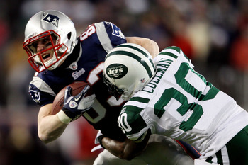 FOXBORO, MA - JANUARY 16:  Drew Coleman #30 of the New York Jets tackles Wes Welker #83 of the New England Patriots during their 2011 AFC divisional playoff game at Gillette Stadium on January 16, 2011 in Foxboro, Massachusetts.  (Photo by Elsa/Getty Imag