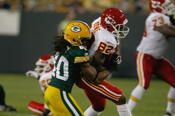 GREEN BAY, WI - SEPTEMBER 1: Dwayne Bowe #82 of the Kansas City Chiefs is tackled by Josh Gordy #40 of the Green Bay Packers during a preseason game at Lambeau Field on September 1, 2011 in Green Bay, Wisconsin. (Photo by Scott Boehm/Getty Images)