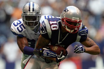 IRVING, TX - OCTOBER 14:  Cornerback Jacques Reeves #35 of the Dallas Cowboys tackles Jabar Gaffney #10 of the New England Patriots at Texas Stadium on October 14, 2007 in Irving, Texas.   (Photo by Ronald Martinez/Getty Images)