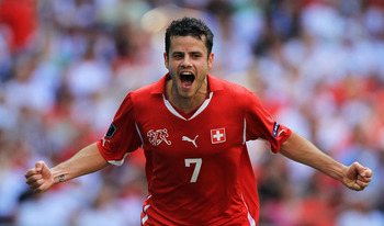 LONDON, ENGLAND - JUNE 04:  Tranquillo Barnetta of Switzerland celebrates scoring the second goal during the UEFA EURO 2012 group G qualifying match between England and Switzerland at Wembley Stadium on June 4, 2011 in London, England.  (Photo by David Ca