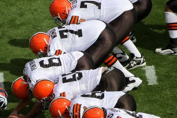 DENVER - SEPTEMBER 20:  The Cleveland Browns offensive line takes the line of scrimmage against the Denver Broncos for a field goal attempt during NFL action at Invesco Field at Mile High on September 20, 2009 in Denver, Colorado. The Broncos defeated the