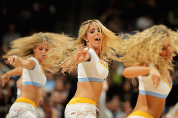 DENVER, CO - MARCH 21:  Members of the Denver Nuggets Dance Team perform during a break in the action against the Toronto Raptors at the Pepsi Center on March 21, 2011 in Denver, Colorado. The Nuggets defeated the Raptors 123-90. NOTE TO USER: User expres