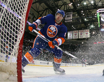 UNIONDALE, NY - MARCH 02:  John Tavares #91 of the New York Islanders skates against the Minnesota Wild at the Nassau Coliseum on March 2, 2011 in Uniondale, New York. The Islanders defeated the Wild 4-1.  (Photo by Bruce Bennett/Getty Images)