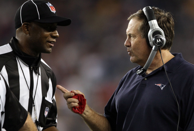 FOXBORO, MA - SEPTEMBER 01:  Head coach Bill Belichick of the New England Patriots talks with against the New England Patriots official to challenge a ruling on the field during the game against the New York Giants on September 1, 2011 at Gillette Stadium