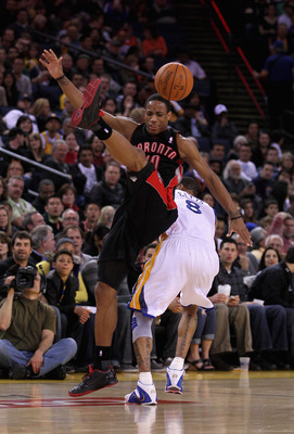 OAKLAND, CA - MARCH 25: DeMar DeRozan #10 of the Toronto Raptors and Monta Ellis #8 of the Golden State Warriors collide going for the ball at Oracle Arena on March 25, 2011 in Oakland, California. NOTE TO USER: User expressly acknowledges and agrees that