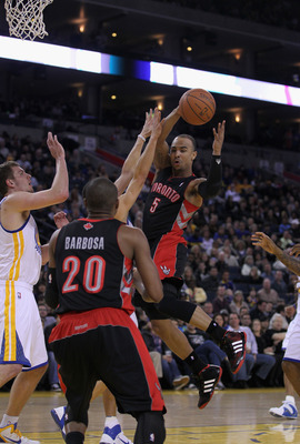 OAKLAND, CA - MARCH 25: Jerryd Bayless #5 of the Toronto Raptors passes the ball during their game against the Golden State Warriors at Oracle Arena on March 25, 2011 in Oakland, California. NOTE TO USER: User expressly acknowledges and agrees that, by do