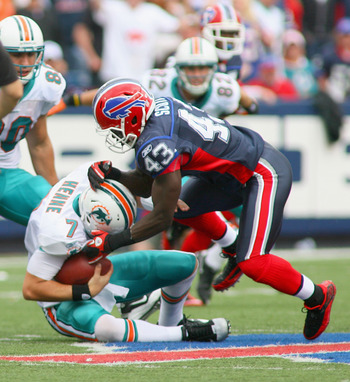 ORCHARD PARK, NY - SEPTEMBER 12: Bryan Scott #43  of the Buffalo Bills sacks Chad Henne #7 of the Miami Dolphins during the NFL season opener at Ralph Wilson Stadium on September 12, 2010 in Orchard Park, New York. Miami won 15-10. (Photo by Rick Stewart/