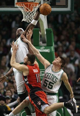 BOSTON, MA - JANUARY 07:  Jermaine O'Neal #7 of the Boston Celtics blocks a shot by Linas Kleiza #11  of the Toronto Raptors as Luke Harangody #55 of the Celtics fouls on January 7, 2011 at the TD Garden in Boston, Massachusetts. NOTE TO USER: User expres