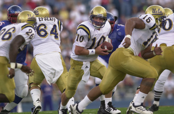 LAWRENCE, KANSAS - SEPTEMBER 8:  Quarterback Cory Paus #10 of the UCLA Bruins drops back to hand the ball off during the NCAA football game against the Kansas Jayhawks on September 8, 2001 at Memorial Stadium in Lawrence, Kansas. The Bruins defeated the J