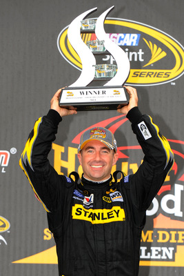 WATKINS GLEN, NY - AUGUST 15:  Marcos Ambrose, driver of the #9 Stanley Ford, poses in Victory Lane after winning the NASCAR Sprint Cup Series Heluva Good! Sour Cream Dips at the Glen at Watkins Glen International on August 15, 2011 in Watkins Glen, New Y