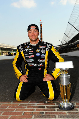 INDIANAPOLIS, IN - JULY 31:  Paul Menard, driver of the #27 NIBCO/Menards Chevrolet, poses with the trophy after winning the NASCAR Sprint Cup Series Brickyard 400 at Indianapolis Motor Speedway on July 31, 2011 in Indianapolis, Indiana.  (Photo by Jason