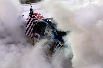 BRISTOL, TN - AUGUST 27:  Brad Keselowski, driver of the #2 Miller Lite Dodge, celebrates with a burnout after winning the NASCAR Sprint Cup Series Irwin Tools Night Race at Bristol Motor Speedway on August 27, 2011 in Bristol, Tennessee.  (Photo by Erine