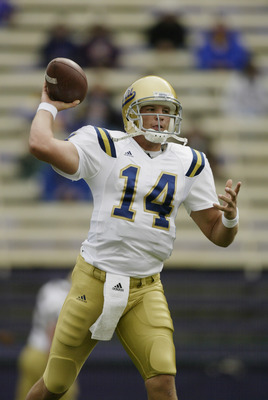 SEATTLE - SEPTEMBER 18:  Quarterback Drew Olson #14 of the UCLA Bruins practices before playing against the Washington Huskies during the game on September 18, 2004 at Huskies Stadium in Seattle, Washington.  The Bruins defeated the Huskies 37-31.  (Photo