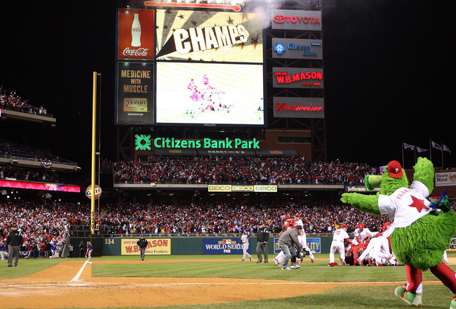 PHILADELPHIA - OCTOBER 29:  The Philly Phanatic runs on the field as the Philadelphia Phillies pile up on top of closing pitcher Brad Lidge after they won 4-3 wo win the World Series against the Tampa Bay Rays during the continuation of game five of the 2
