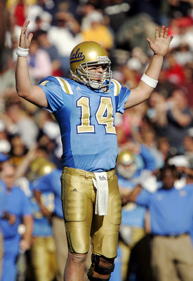 EL PASO, TEXAS - DECEMBER 30:  Quarterback Drew Olson #14 of the UCLA Bruins celebrates a touchdown against the Northwestern Wildcats in the second quarter during the Vitalis Sun Bowl on December 30, 2005 at the Sun Bowl in El Paso, Texas. The Bruins defe