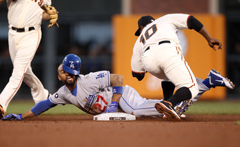 SAN FRANCISCO, CA - APRIL 11:  Matt Kemp #27 of the Los Angeles Dodgers steals second base past Miguel Tejada #10 of the San Francisco Giants in the second inning during an MLB game at AT&T Park on April 11, 2011 in San Francisco, California.  (Photo by J