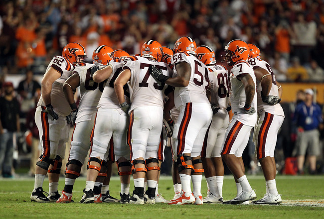 MIAMI, FL - JANUARY 03:  The Virginia Tech Hokies offense stands in the huddle against the Stanford Cardinal during the 2011 Discover Orange Bowl at Sun Life Stadium on January 3, 2011 in Miami, Florida. Stanford won 40-12. (Photo by Streeter Lecka/Getty
