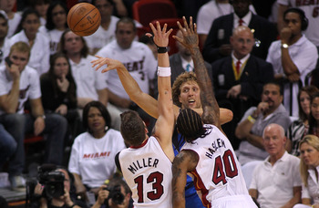 MIAMI, FL - JUNE 02:  Dirk Nowitzki #41 of the Dallas Mavericks passes the ball out of a double-team by Mike Miller #13 and Udonis Haslem #40 of the Miami Heat in Game Two of the 2011 NBA Finals at American Airlines Arena on June 2, 2011 in Miami, Florida