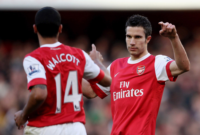 LONDON, ENGLAND - FEBRUARY 12:  Robin Van Persie of Arsenal (R) celebrates with Theo Walcott after scoring their second goal during the Barclays Premier League match between Arsenal and Wolverhampton Wanderers on February 12, 2011 in London, England.  (Ph