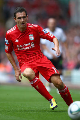 LIVERPOOL, ENGLAND - AUGUST 06:  Stewart Downing of Liverpool in action during the pre season friendly match between Liverpool and Valencia at Anfield on August 6, 2011 in Liverpool, England.  (Photo by Clive Brunskill/Getty Images)