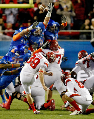 LAS VEGAS, NV - DECEMBER 22:  Members of the Boise State Broncos try to block a field goal by kicker Joe Phillips #39 of the Utah Utes during the MAACO Bowl Las Vegas at Sam Boyd Stadium December 22, 2010 in Las Vegas, Nevada. Boise State Won 26-3.  (Phot