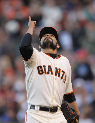 SAN FRANCISCO, CA - JULY 10:  Sergio Romo #54 of the San Francisco Giants reacts after the end of the eighth inning of their game against the New York Mets at AT&T Park on July 10, 2011 in San Francisco, California.  (Photo by Ezra Shaw/Getty Images)
