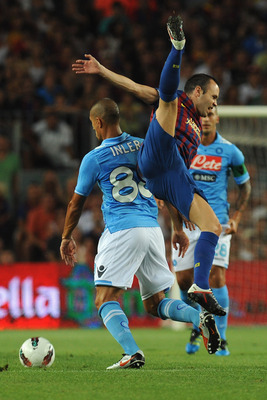 BARCELONA, SPAIN - AUGUST 22:  Andres Iniesta  of FC Barcelona clashes with Gokhan Inler of SSC Napoli during the Joan Gamper Trophy match between FC Barcelona and SSC Napoli on August 22, 2011 in Barcelona, Spain.  (Photo by Valerio Pennicino/Getty Image