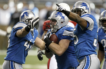 DETROIT - DECEMBER 20:  Zack Follett #49 of the Detroit Lions reacts after recovering a fumble with Cedric Peerman #35 while playing the Arizona Cardinals on December 20, 2009 at Ford Field in Detroit, Michigan. Arizona won the game 31-24.  (Photo by Greg