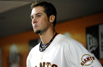 SAN FRANCISCO, CA - AUGUST 30: Pitcher Ryan Vogelsong #32 of the San Francisco Giants looks on from the dugout against the Chicago Cubs in the fifth inning during an MLB baseball game at AT&amp;T Park on August 30, 2011 in San Francisco, California.  (Photo b