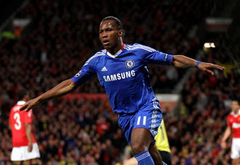 MANCHESTER, ENGLAND - APRIL 12:  Didier Drogba of Chelsea celebrates scoring his team's first goal during the UEFA Champions League Quarter Final second leg match between Manchester United and Chelsea at Old Trafford on April 12, 2011 in Manchester, Engla