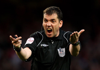 LONDON, ENGLAND - APRIL 02: Referee Phil Dowd gestures during the Barclays Premier League match between Arsenal and Blackburn Rovers at the Emirates Stadium on April 2, 2011 in London, England.  (Photo by Julian Finney/Getty Images)