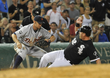 CHICAGO, IL - JULY 25: Ryan Raburn #25 of the Detroit Tigers tags Adam Dunn #32 of the Chicago White Sox out at third base on July 25, 2011 at U.S. Cellular Field in Chicago, Illinois. The White Sox defeated the Tigers 6-3. (Photo by David Banks/Getty Ima
