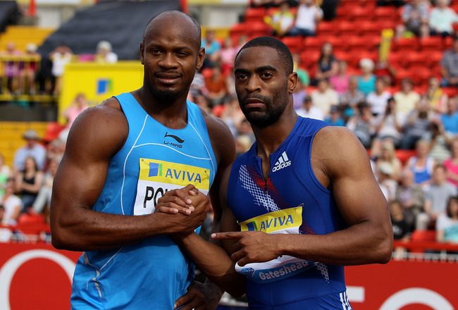 GATESHEAD, ENGLAND - JULY 10:  Tyson Gay (r) and Asafa Powell celebrate after the mens 100 metres final during the Aviva British Grand Prix at Gateshead International Stadium on July 10, 2010 in Gateshead, England.  (Photo by Stu Forster/Getty Images)