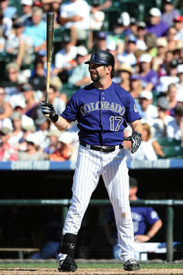 DENVER, CO - AUGUST 20:  Todd Helton #17 of the Colorado Rockies gets ready to bat during the game against the Los Angeles Dodgers at Coors Field on August 20, 2011 in Denver, Colorado.  (Photo by Garrett W. Ellwood/Getty Images)