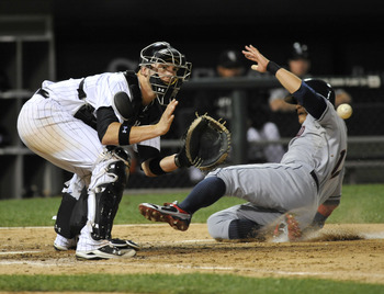 CHICAGO, IL - AUGUST 18: Shin-Soo Choo #17 of the Cleveland Indians slides home safely as Tyler Flowers #17 of the Chicago White Sox takes the throw in the sixth inning on August 18, 2011 at U.S. Cellular Field in Chicago, Illinois.  (Photo by David Banks