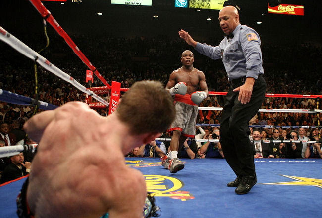 LAS VEGAS - DECEMBER 08:  Floyd Mayweather Jr. knocks down Ricky Hatton of England in the 10th round during their WBC world welterweight championship fight at the MGM Grand Garden Arena on December 8, 2007 in Las Vegas, Nevada.  (Photo by Al Bello/Getty I