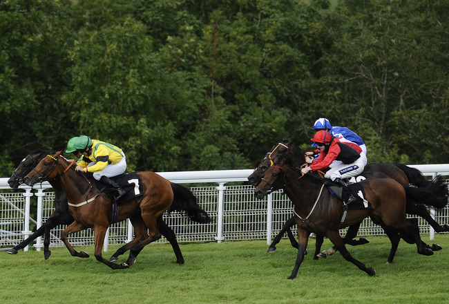CHICHESTER, ENGLAND - AUGUST 28:  Richard Hughes riding Libranno (L) win The Supreme Stakes from Jacqueline Quest (2L) at Goodwood racecourse on August 28, 2011 in Chichester, England. (Photo by Alan Crowhurst/Getty Images)