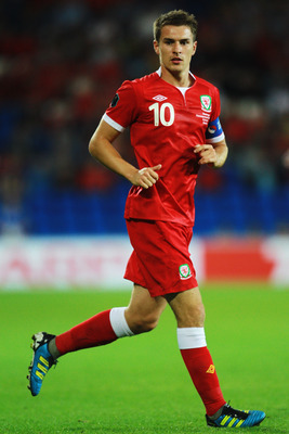 CARDIFF, WALES - SEPTEMBER 02:  Aaron Ramsey of Wales in action during the UEFA EURO 2012 group G qualifying match between Wales and Montenegro at the Cardiff City Stadium on September 2, 2011 in Cardiff, Wales.  (Photo by Paul Gilham/Getty Images)
