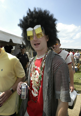 A fan parties in the infield at the 131st Preakness Stakes at Pimlico Race Track in Baltimore, Maryland on Saturday, May 20th, 2006. (Photo by Hunter Martin/Getty Images)