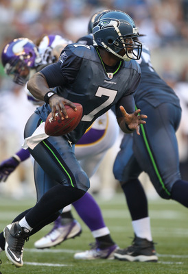 SEATTLE - AUGUST 20:  Quarterback Tarvaris Jackson #7 of the Seattle Seahawks scrambles against the Minnesota Vikings at CenturyLink Field on August 20, 2011 in Seattle, Washington. The Vikings won 20-7. (Photo by Otto Greule Jr/Getty Images)