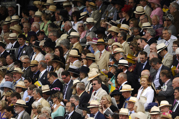 CHICHESTER, ENGLAND - JULY 26: Racegoers, many of them wearing Panama hats, look on from the grandstand at Goodwood racecourse on July 26, 2011 in Chichester, England. (Photo by Alan Crowhurst/Getty Images)