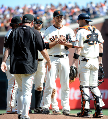 SAN FRANCISCO, CA - AUGUST 31: Manager Bruce Bochy #15 of the San Francisco Giant comes out to talk with Madison Bumgarner #40, Chris Stewart #37 and infielders against the Chicago Cubs in the eighth inning during an MLB baseball game at AT&T Park on Augu